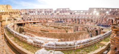 Small Group Colosseum and Roman Forum Guided Tour - Colosseum interior wide panoramic view from the seating area with lots of tourists visiting this monumental ancient european touristic attraction.JPG