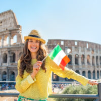 Colosseum and Ancient Rome Walking Tour - Portrait of happy young woman with italian flag in front of colosseum in rome, italy.JPG