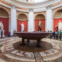 Vatican Museums and Sistine Chapel Fast -Track Entry - visitors near statues, Hercules figure and round monolithic porphyry basin in Round Room of Pio-Clementino Museum in Vatican museums in Vatican city.JPG
