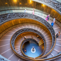 Omnia Card -  Vatican & Rome City Pass +Transportation - Double spiral stairs in the Vatican Museums, Rome, Italy. View of the old spiral staircase from above. Tourists descend the beautiful spiral stairs..JPG