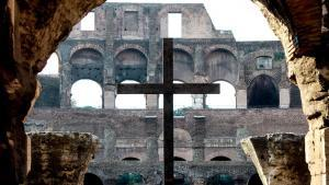 crucifix stands at the Roman Coliseum.