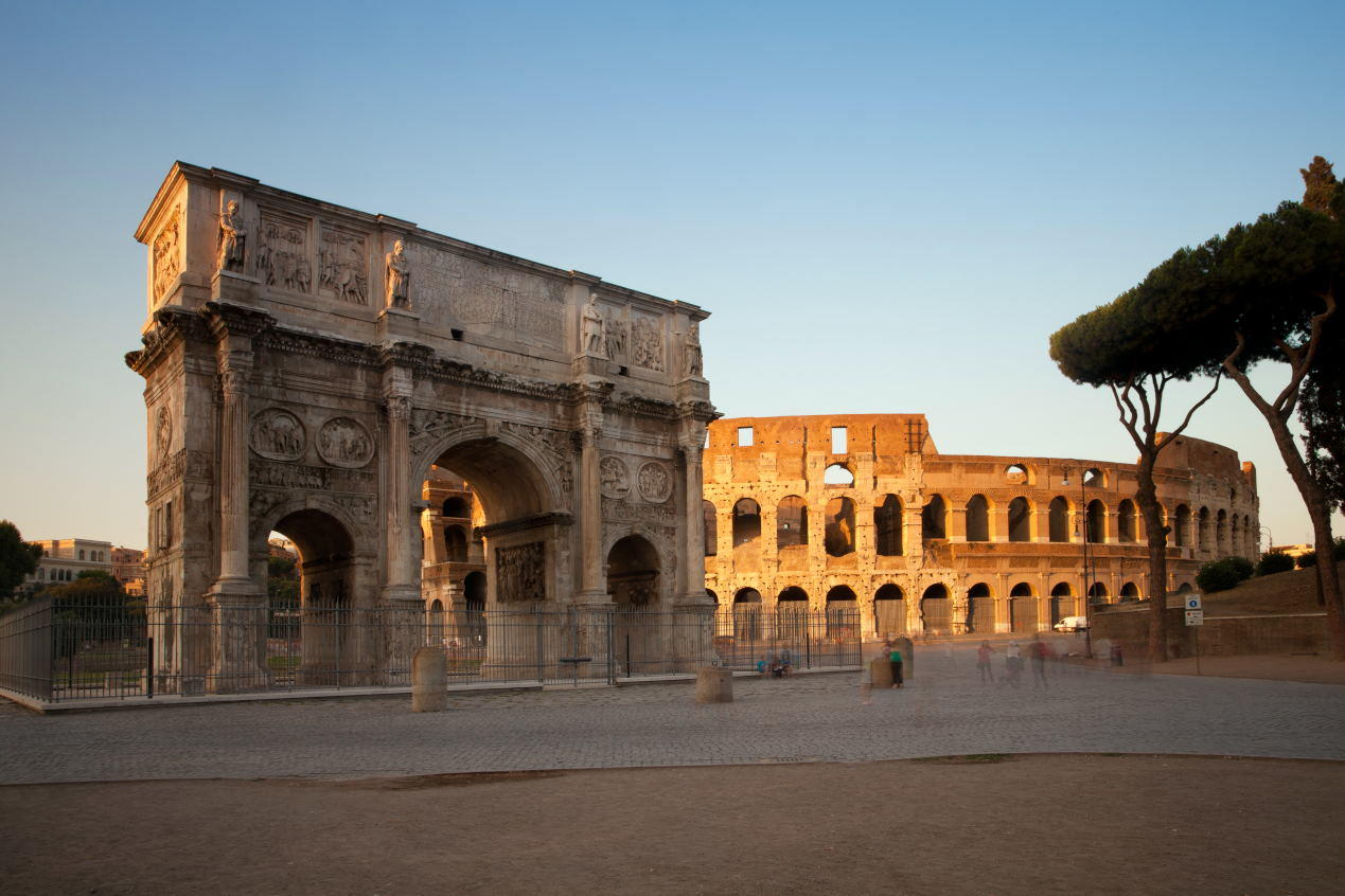 Arch of Constantine and Colosseum at sunset, Rome, Italy