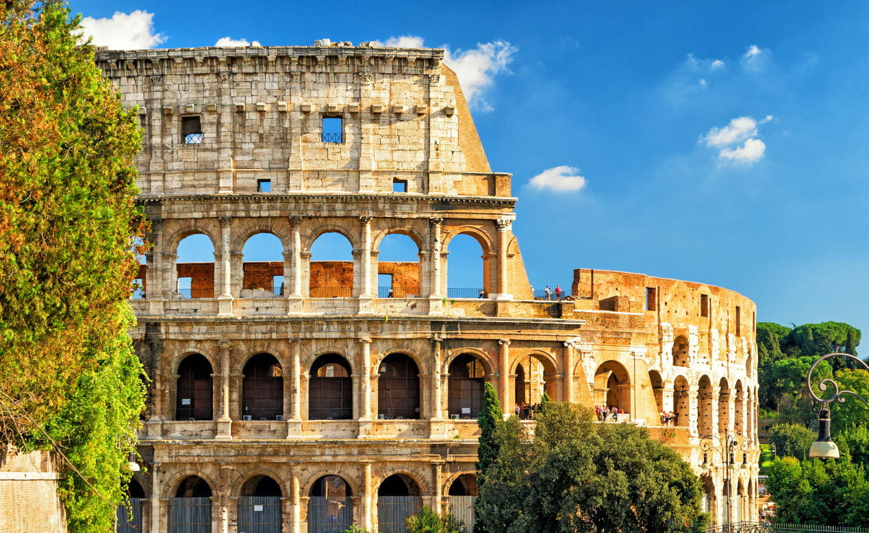 Colosseum (Coliseum) in Rome, Italy. Roman Coliseum is one of the main travel attractions of Rome. Colosseum is the largest amphitheatre ever built. Historical architecture of central Rome.