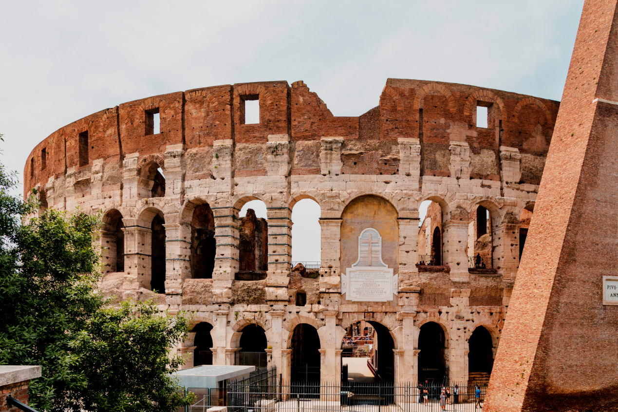 Colosseum (Coliseum) in Rome, Italy. Roman Colosseum is one of the main travel attractions of Rome. Panoramic view of Rome with Coliseum. Historical architecture of central Rome.