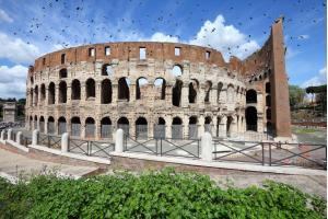 Colosseum in Rome. Ominous black birds.