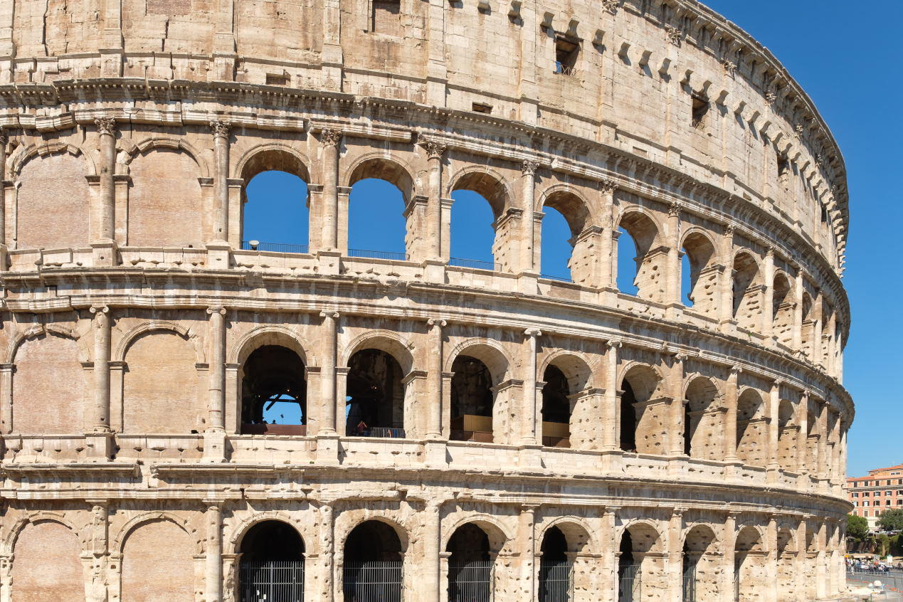 Facade of the Colosseum in central Rome on a sunny summer day