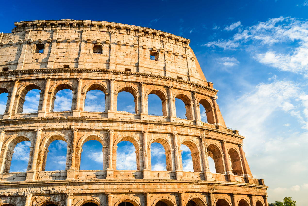 Rome, Italy. Colosseum in Roma, Italia. Symbol of the ancient city. Amphitheatre in sunset light.