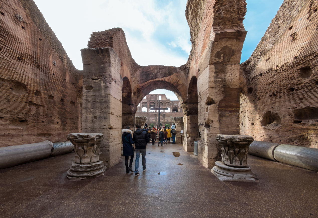 The archeological ruins in historic center of Rome, named Imperial Fora. Here the Colosseum.