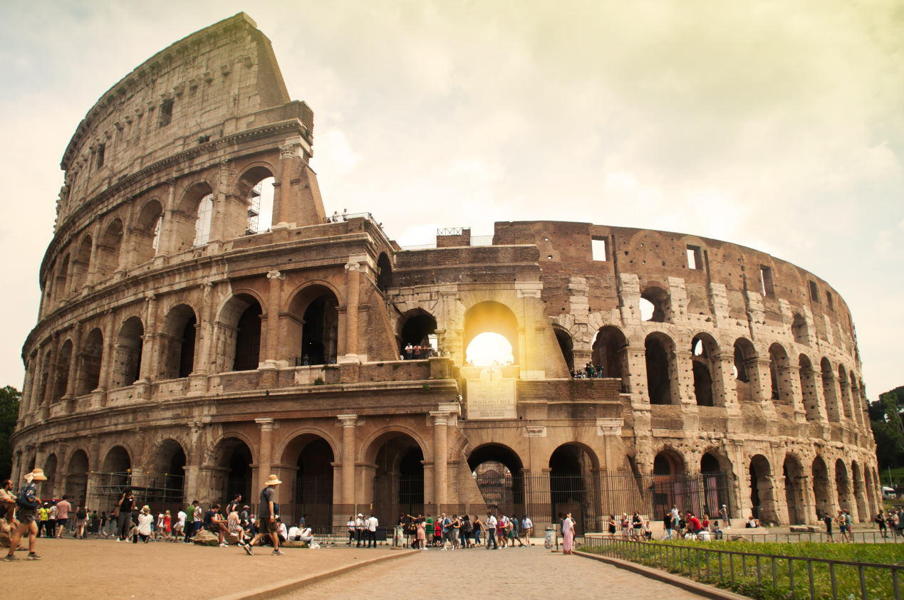 The colosseum background in the morning scene is a landmark in Rome of Italy that is an one of amazing fascinate of 7 wonder places in the world for traveling in summer