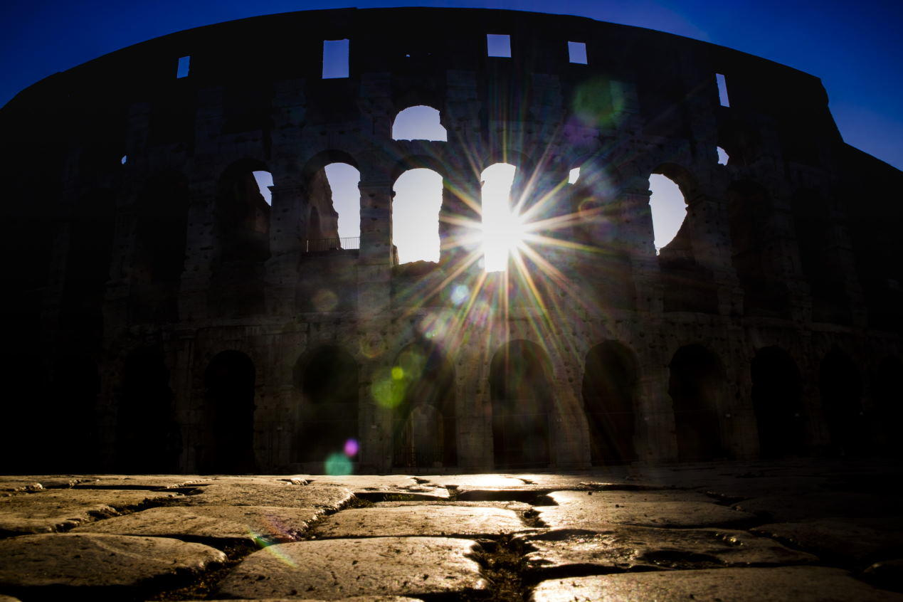 The monument of the Colosseum in Rome Italy taken back in against light to the dawn