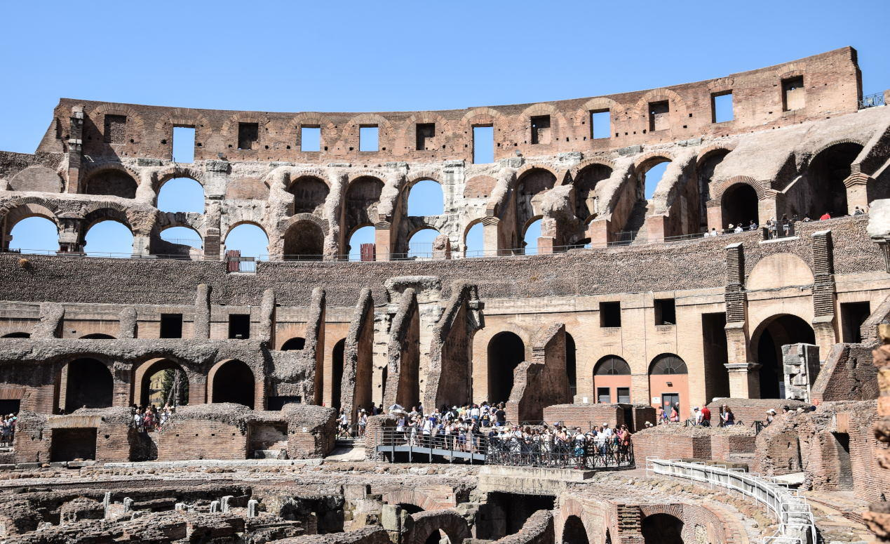 Tourists touring around the Roman Colosseum