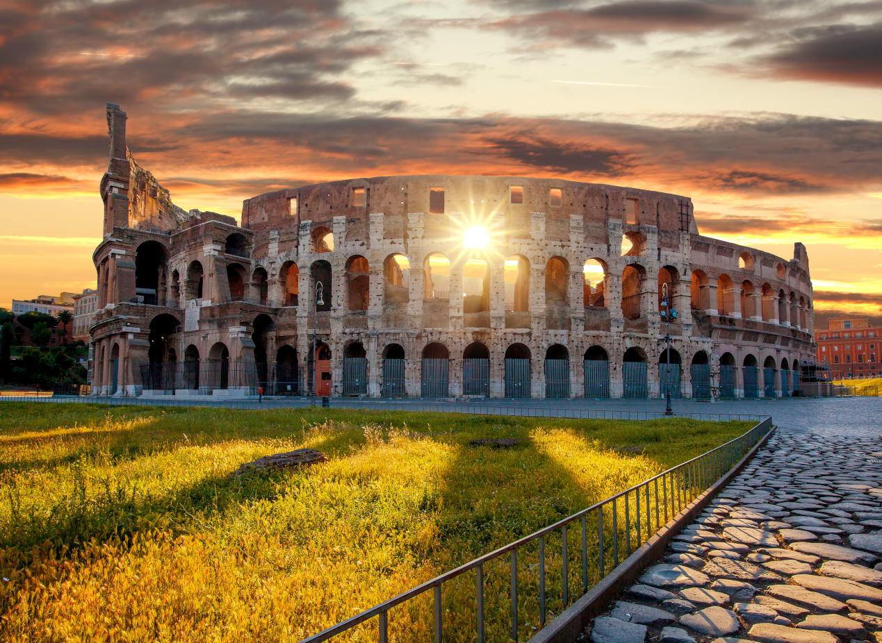 Who is the Colosseum's Architect - Colosseum against colorful sunset in Rome, Italy