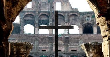 A crucifix stands at the Roman Coliseum.