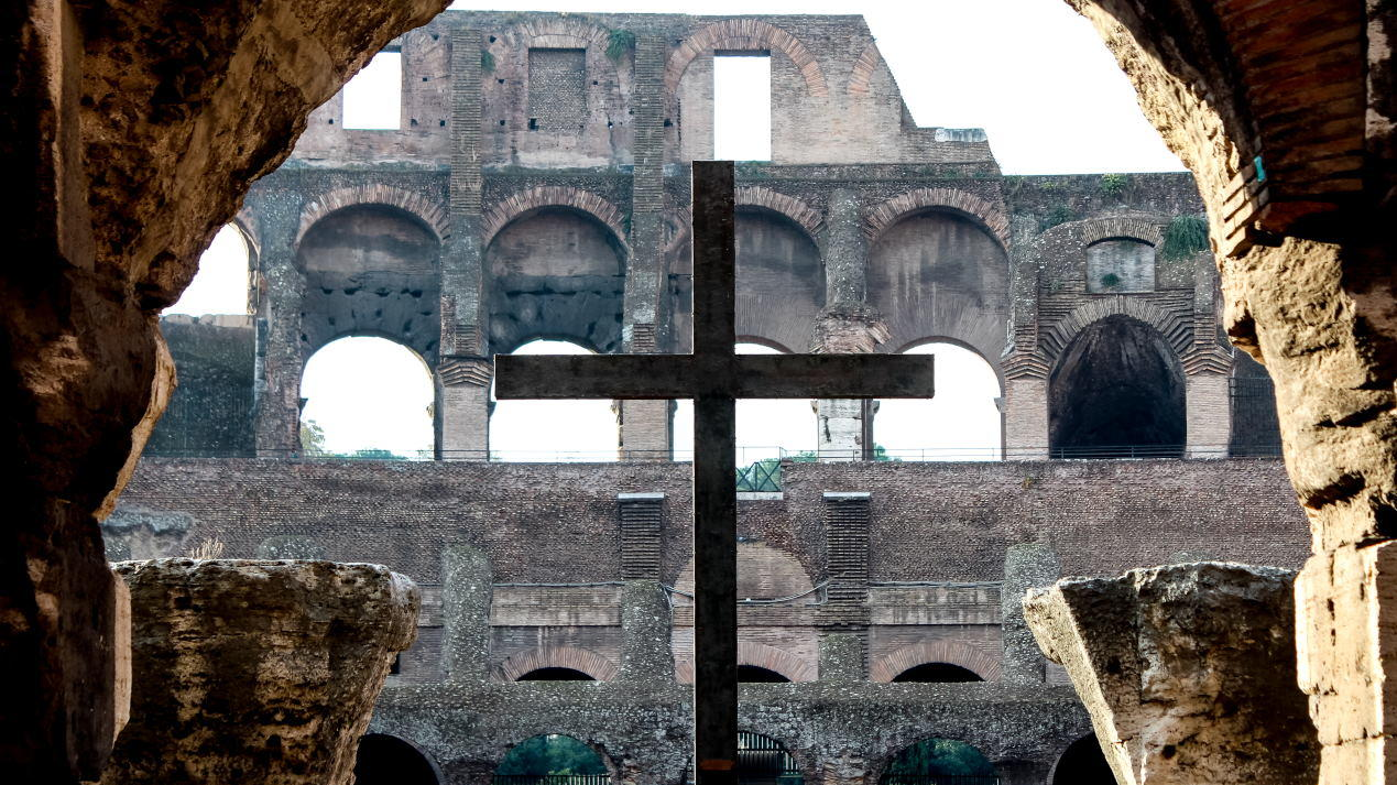 A crucifix stands at the Roman Coliseum.