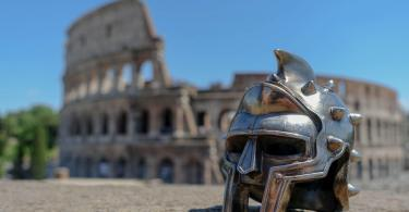 Gladiator mask in front of Colosseum in Rome, Italy