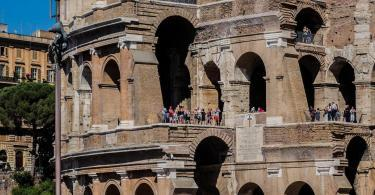 Iconic ancient Colosseum. Colosseum is probably most impressive building of Roman Empire. Originally known as Flavian Amphitheater, it was largest building of the era.