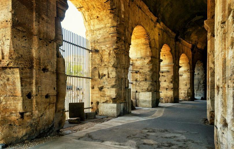 Inside the Colosseum or Coliseum, Italy. Colosseum is one of main travel destinations in Europe. Ancient interior of Colosseum. The passage inside the Colosseum in sunlight.