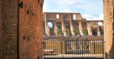 Tourists visit the Roman vestiges inside the Colosseum, major touristic attraction in Rome, Italy-3