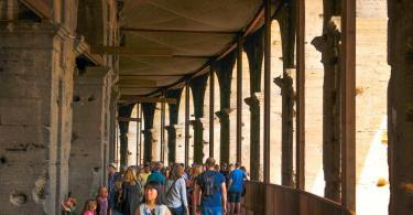 Tourists visit the Roman vestiges inside the Colosseum, major touristic attraction in Rome, Italy