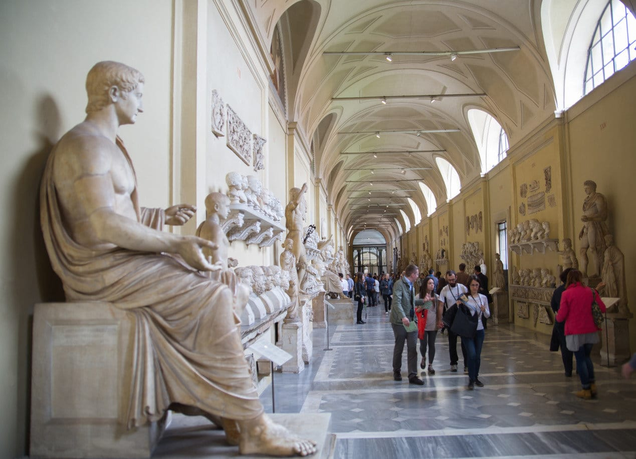 Roman marble sculptures from Museums of Vatican. Exhibition hall with lots to people