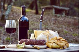 Things to do in Sardinia - Traditional dinner of Sardinia made of cheese, sausage, bread and wine.