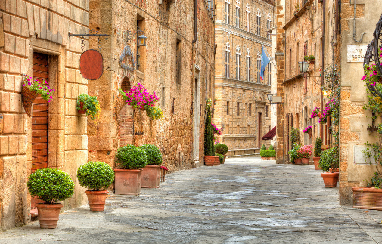 Things to do in Tuscany - Colorful street in Pienza, Tuscany, Italy