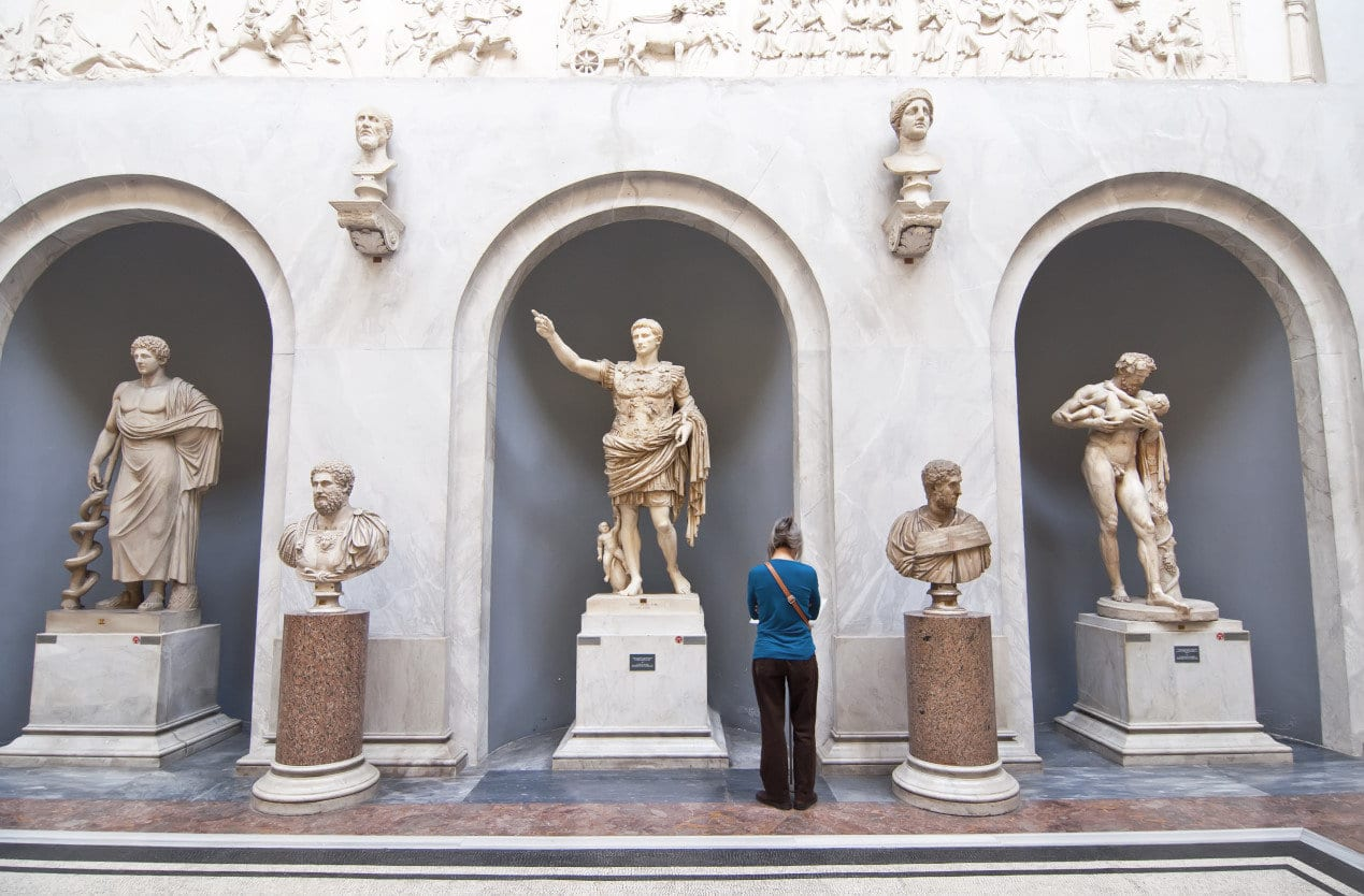 Tourists visiting the statues in the halls of the Vatican Museums in Rome, Italy