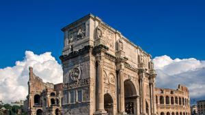Arch of Constantine and The Colosseum at the Roman Forum in Rome, Italy