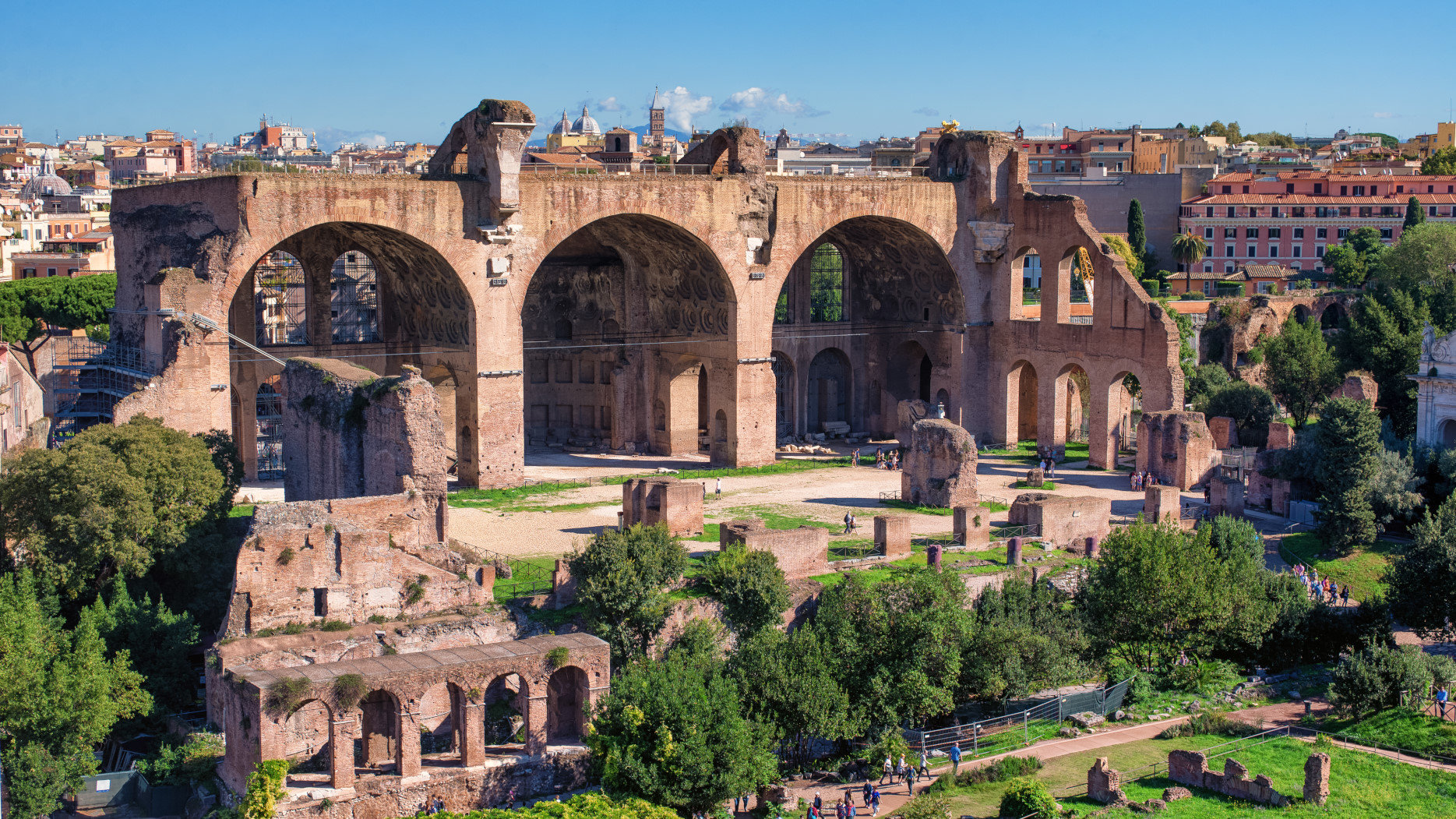 Red stone Basilica of Maxentius with arcs in Rome, Italy