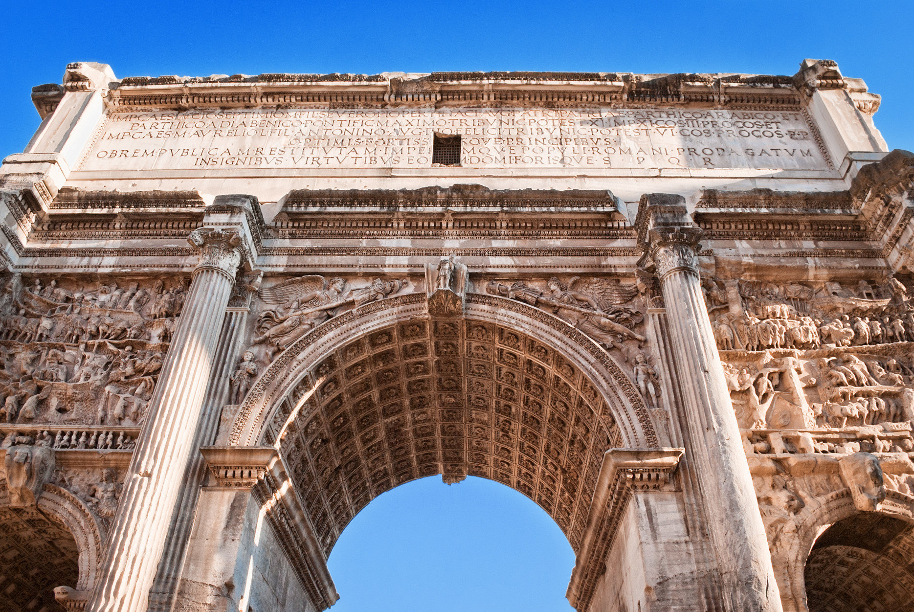 The Arch of Titus at the Forum ruins in Rome, Italy.