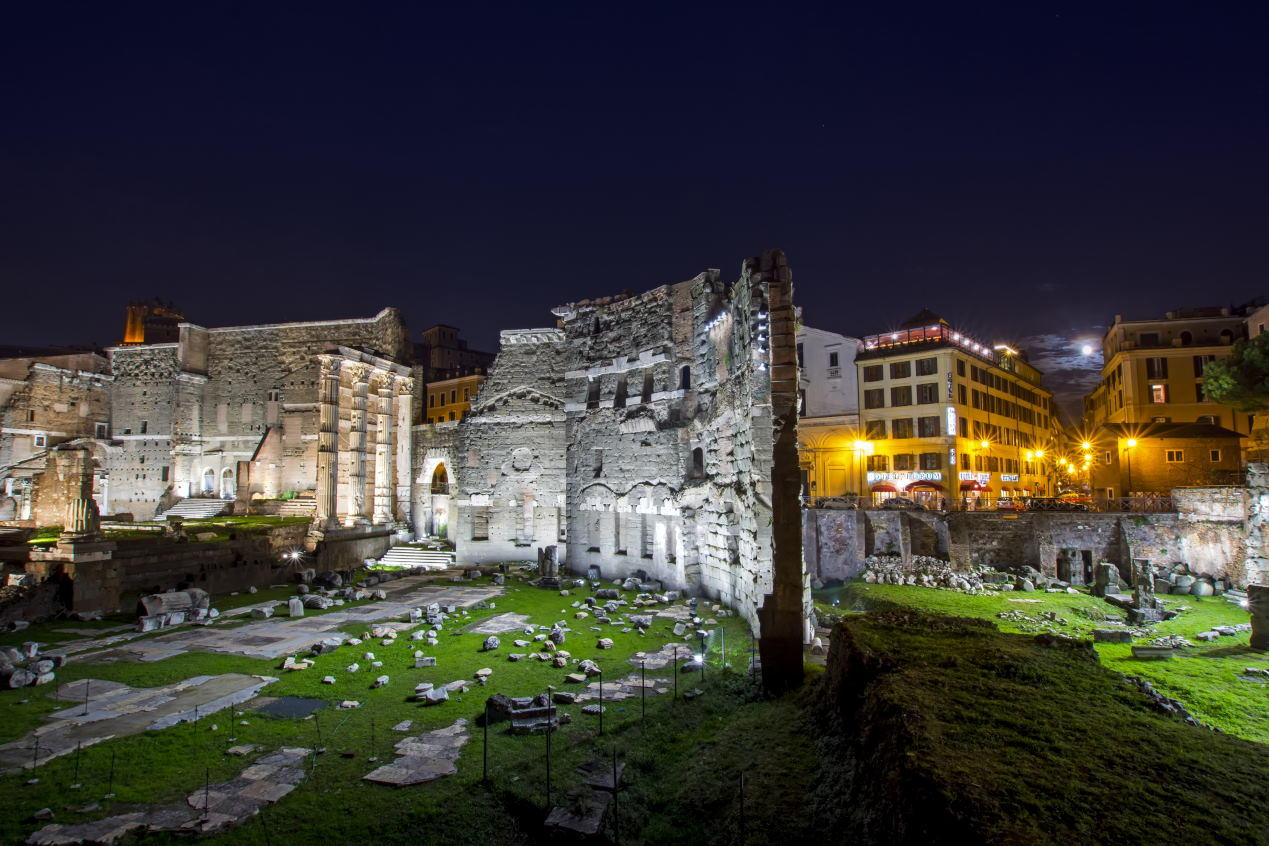 Forum of Augustus and Forum Hotel lit up at night. Beautiful night cityscape suitable for backgrounds.