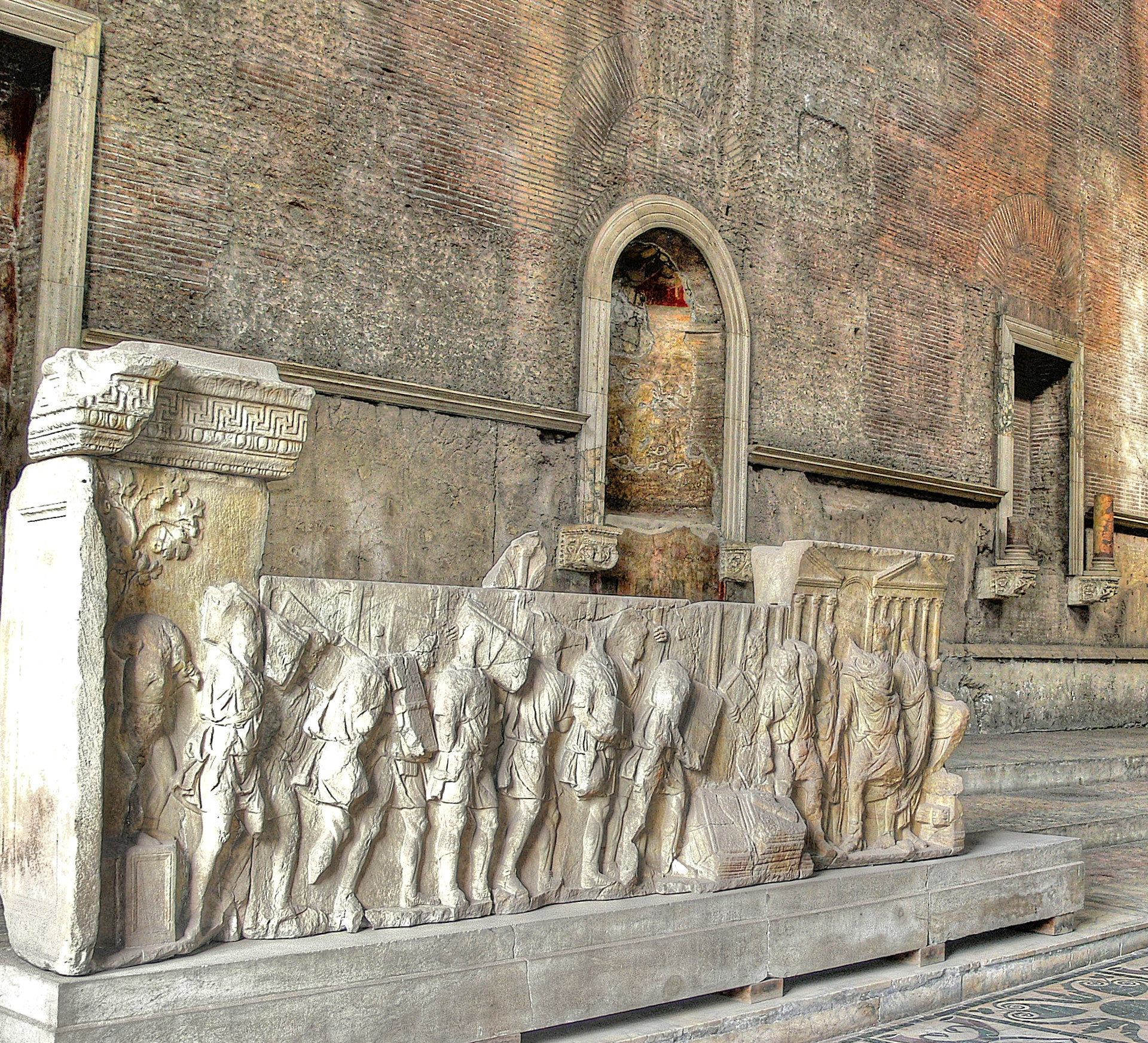 Marble carvings, perhaps the parapets of the tiered seating, with scenes of the reign of Trajan (98-117 AD) destruction of the debt wlls and (right) institution of the public food supply.