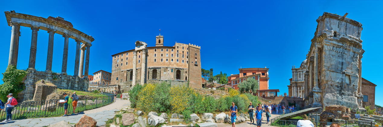 Panoramic view at the Roman Forum with the Temple of Saturn, the Tabularium, the Temple of Vespasian and Titus, and the Arch of Septimius Severus.