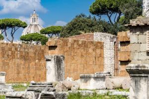 Remains of Basilica Aemilia, Roman Forum, Rome, Italy. Antique roman temple ruins, baroque church in background.