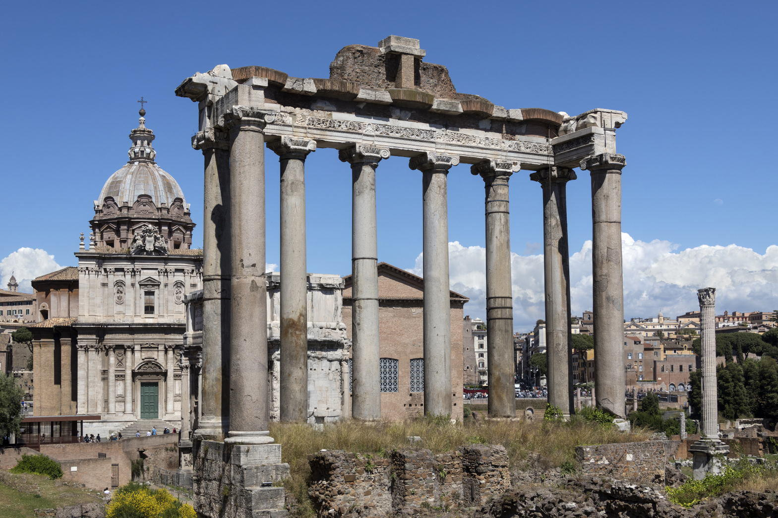 Temple of Saturn in the Roman Forum in the city of Rome, Italy. Gradual collapse over the centuries has left nothing but the front portico standing.