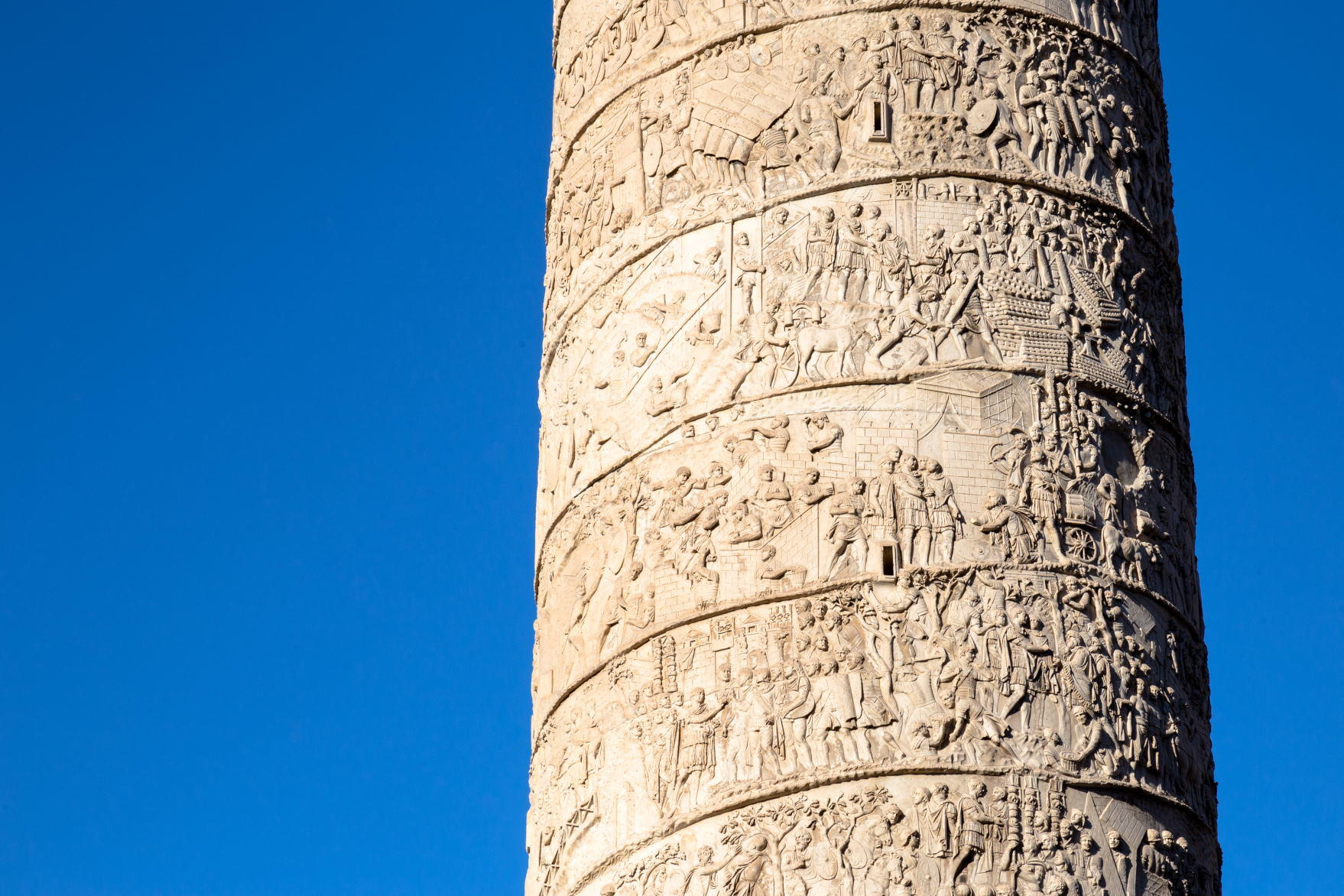 The Column of Trajan in the morning light in Rome, Italy.