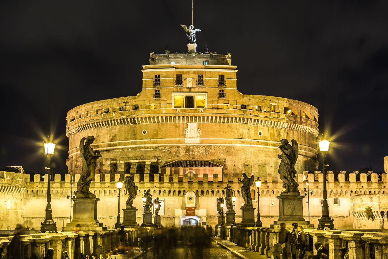 The Mausoleum of Hadrian, usually known as Castel Sant'Angelo and the Sant'Angelo bridge illuminated by night.