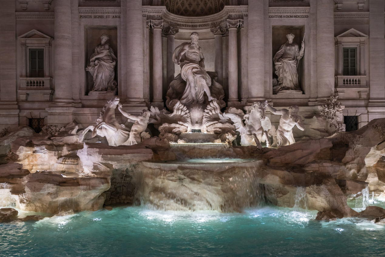The sculptures of the Ocean and the two tritons, with the winged horses in the central part in Trevi Fountain by night.