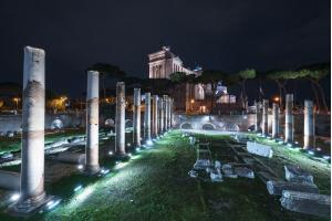 A nightly view of the Basilica Ulpia in Rome, Italy