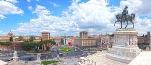 Piazza Venezia, view from Vittoriano (The Altare della Patria). Panorama of Rome. Italian flags. Statue of Victor Emmanuel II