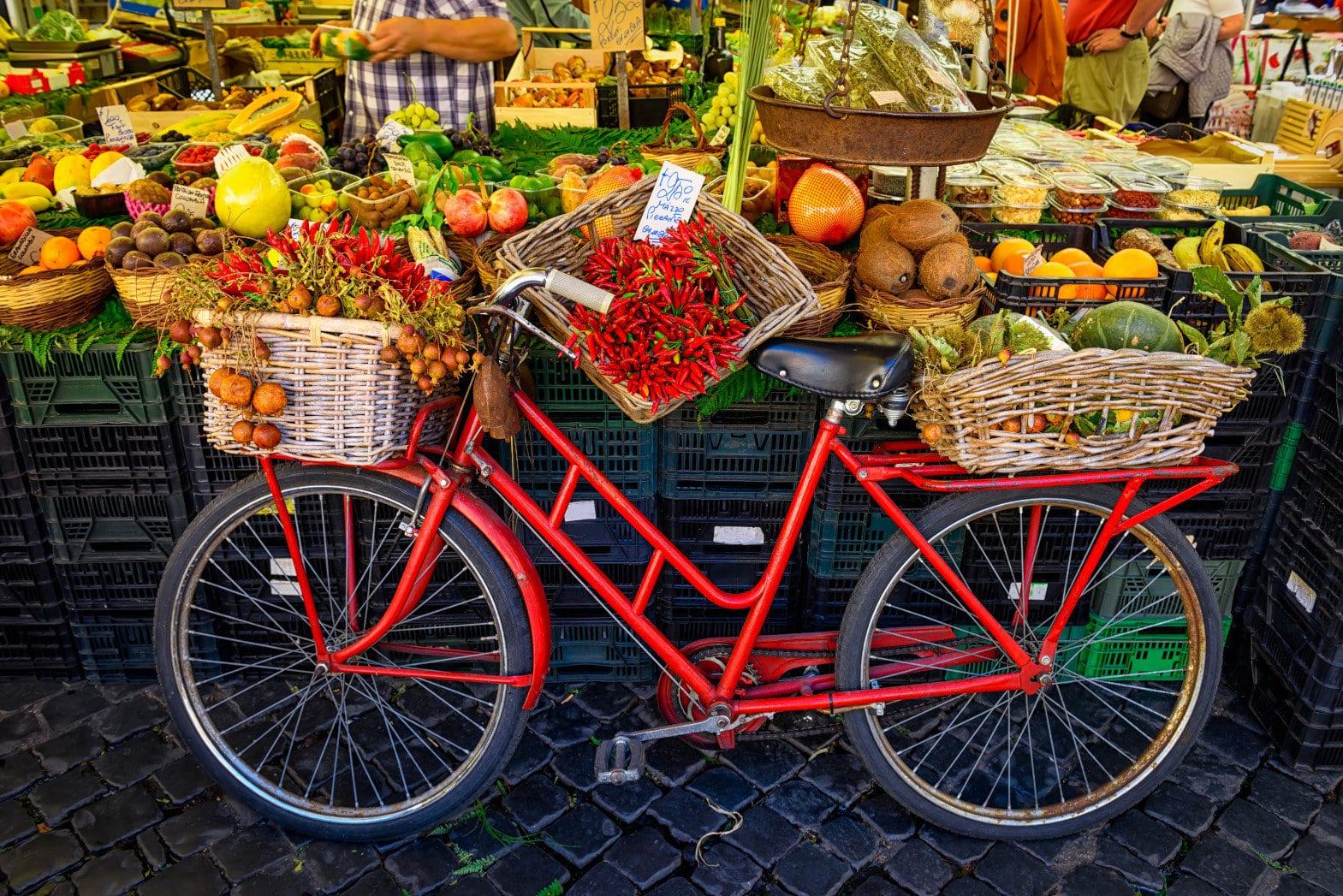 Red old bike in market on Campo di Fiori, Rome, Italy. Rome market on Piazza Campo di Fiori is landmark of Rome.