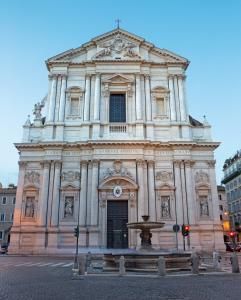 Rome - The baroque portal of church Basilica di Sant'Andrea della Valleat dusk.