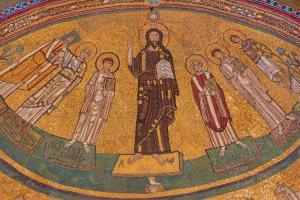 The apse mosaic of Christ among the saints in byzantine style in church Basilica di San Marco from the 9. cent. commissioned by Pope St Gregory IV by unknown artist.
