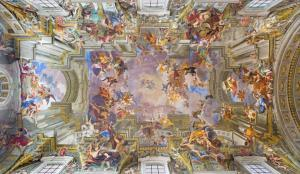 The vault baroque fresco The Apotheosis of St Ignatius by jesuit frater Andrea Pozzo (1685) in church Chiesa di Sant' Ignazio.