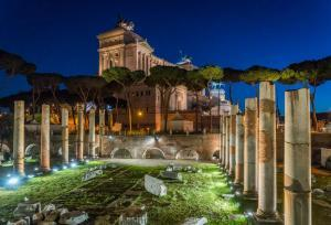 Vittorio Emanuele II monument at night, as seen from the Basilica Ulpia ruins, in Rome, Italy.