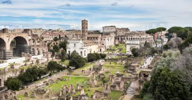 Colosseum Express Guided Tour - Roman Forum southeast side, view from Palatine hill, Rome, Italy. In the background the Coliseum.