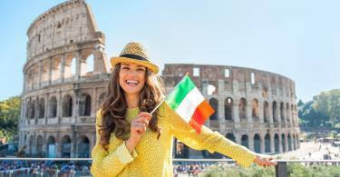 Colosseum and Ancient Rome Walking Tour - Portrait of happy young woman with italian flag in front of colosseum in rome, italy