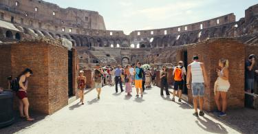 Colosseum and Ancient Rome Walking Tour- Tourist visit the interior of the Colosseum. Colosseum is famous landmark