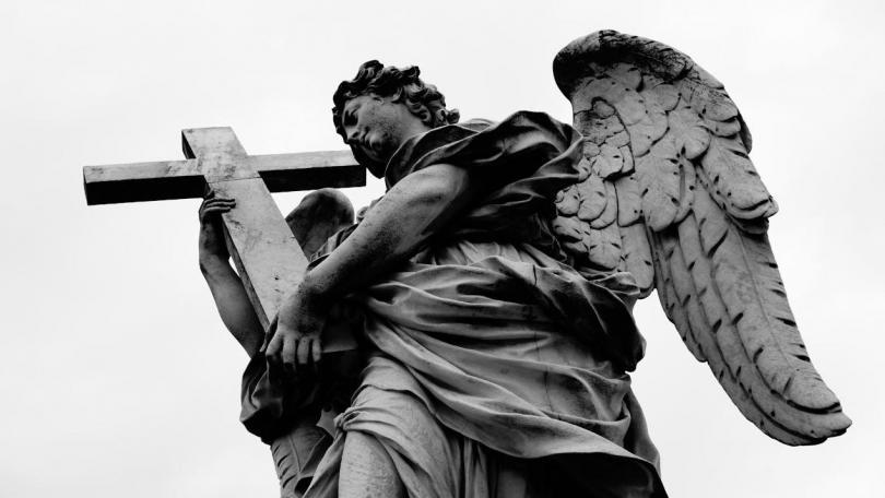 Rome Angels and Demons Guided Half-Day Tour - Angels of the bridge of Castel Sant'angelo (Ponte Sant'Angelo) taken from below in black and white.