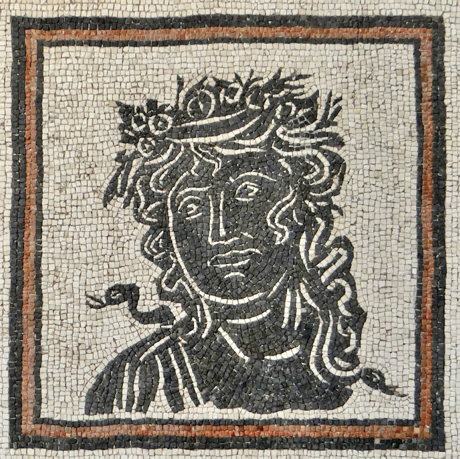 Geometric mosaic pavement with head of a season, 3th c. A.D.